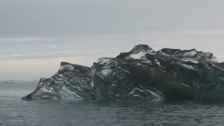 Clear Iceberg melting in Jokulsarlon lake Iceland. View from a boat