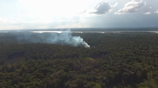 Dramatic Slash-and-burn agriculture in Guiana, amazonian forest. Fire aerial