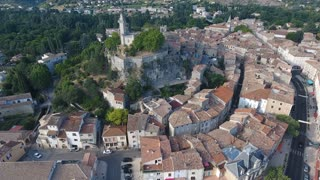 Flying over the city of Saint ambroix. Rural village south of France.