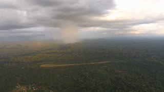 Heavy rainfall over amazonian rainforest in Saül. French Guiana by drone sunset