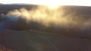 Majestic steamy waterfall Detifoss in Iceland. Drone sunset view