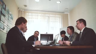 Meeting of Directors of a large company. a business conversation. the camera moves slowly to the right