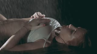 Sexy girl basking under the water. Slow motion.