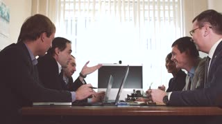 The top managers team discusses action plan
