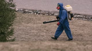 Virologist man in protective costume and respirator gas mask.