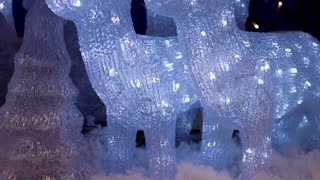 Close-up of glowing Christmas decorative animals
