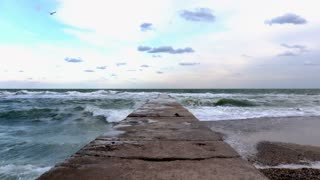 View of the pier and the sea in windy weather