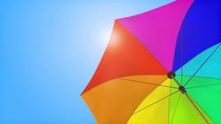 Loop: Sun umbrella under summer sky