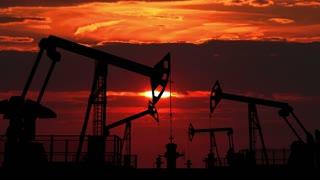 Oil pumpjacks against red dusk