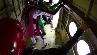 KYIV, UKRAINE - JULY, 2015: Skydivers jump out of an airplane. Accelerated free fall (AFF course) lessons in drop zone Chayka, Kyiv region.
