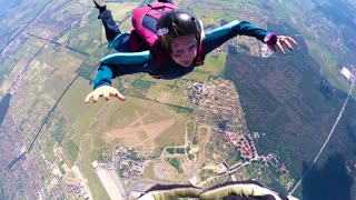 KYIV, UKRAINE - MAY, 2015: Skydiver spinning and flipping in the air. Accelerated free fall (AFF course) lessons in drop zone Chayka, Kyiv region.