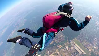 KYIV, UKRAINE - MAY, 2015: Skydiver spinning in the air. Accelerated free fall (AFF course) lessons in drop zone Chayka, Kyiv region.