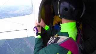 KYIV, UKRAINE - MAY, 2015: Skydivers jump out of an airplane. Accelerated free fall (AFF course) lessons in drop zone Chayka, Kyiv region.