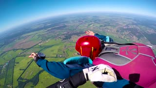 Skydiver in free fall opening parachute