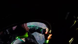 Skydivers jump out of an airplane and free fall