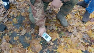 A man using dosimeter for measure level radioactivity at distance ten kilometers in exclusion zone in ghost city Pripyat Ukraine
