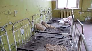 Abandoned bedroom and toys in kindergarten in exclusion zone Chernobyl Ukraine