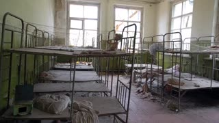 Abandoned bedroom in kindergarten ghost town Pripyat Ukraine