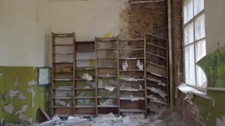 Abandoned class room and old book lying on floor kindergarten in Pripyat Ukraine