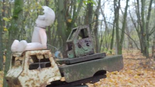 Broken childrens toy doll and car truck in abandoned ghost town Pripyat Ukraine