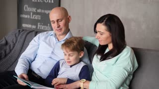 Child is reading with parents