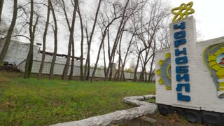 Memorial city name sign on highway to ghost town Chernobyl Ukraine