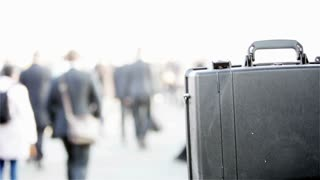 Business commuters with briefcase copy space