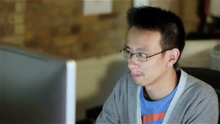 Computer programmer: concentrating on his code