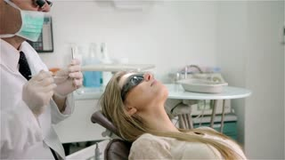 Dental surgery: dentist and patient in the surgery