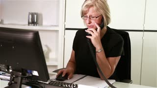 Dental surgery: healthcare receptionist on the phone