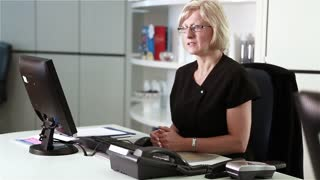 Dental surgery: healthcare receptionist talking to client
