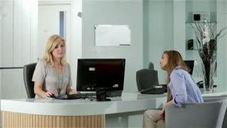 Dental surgery: reception desk scene