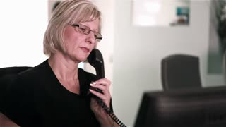 Dental surgery: receptionist on the telephone