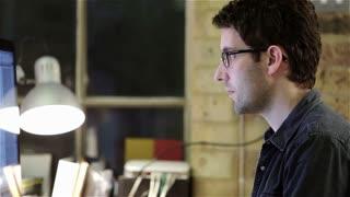 Design studio: designer at computer close-up