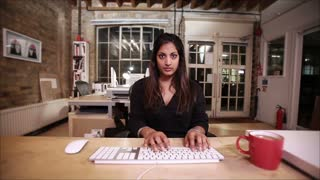 Design studio: female office worker contemplates solving a problem