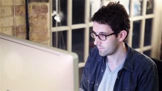 Design studio: Graphic designer at computer