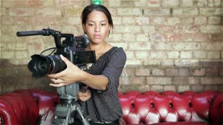 Female video camera operator