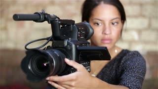 Female video camera operator