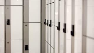 Gym member takes bag from locker