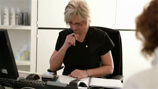 Healthcare receptionist sorting paperwork