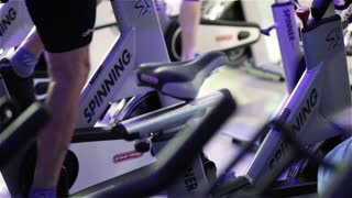 LONDON, UK - 17 NOVEMBER 2011: Video footage with close-up detail on the feet of a spinning class as they pedal on their exercise bikes.
