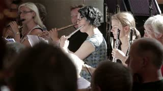 Orchestra rehearsal: flute and oboe players