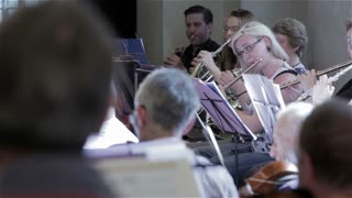 Orchestra rehearsal: flute player