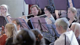 Orchestra rehearsal: flutes and woodwind