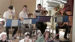 Orchestra rehearsal: trombones and tuba