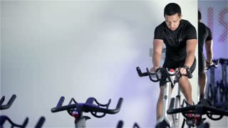 Spinning class: instructor demonstrating