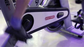 Spinning class: pedalling feet on Star Trac spinner bike
