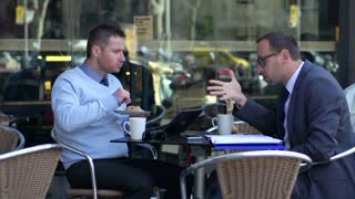 businessmen discussing about work and sitting in cafe, slow motion shot at 60fps