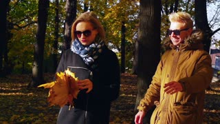 Angry girl beating her boyfriend with leaves, steadycam shot, slow motion shot a
