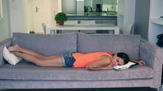Attractive woman sleeping on the sofa at home